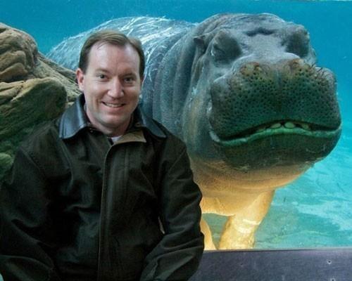 Funny guy and funny hippo photobomb